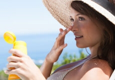 Woman-in-applying-sunscreen-on-the-face-2